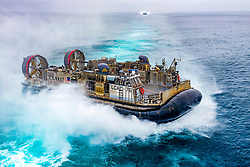 180927-N-WY048-1027 <br /> PACIFIC OCEAN (Sept. 27, 2018) Landing Craft, air Cushion (LCAC) 76, assigned to Assault Craft Unit (ACU) 5, approaches  the well deck of the amphibious assault ship USS Bonhomme Richard (LHD 6). Bonhomme Richard is operating in the 3rd Fleet area of operations. (U.S. Navy photo by Mass Communication Specialist Seaman Hector Carrera/Released)