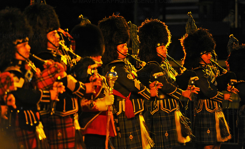 Dancers, musicians,stunt men and women put on a colourful show at the dress rehearsal of this years 60th Edinburgh Military Tattoo at Edinburgh Castle Esplanade. The event is the largest gathering of military musicians in the UK with participants from as far a field as Africa, America and Asia.  Pictured the Mass Pipes and Drums.