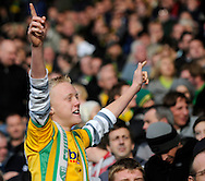Carlisle - Saturday October 10th, 2009: A Norwich City fan celebrates their win during the Coca Cola League One match at Brunton Park, Carlisle. (Pic by Jed Wee/Focus Images)..