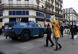 """Police clash on Saturday december 8, 2018 in Paris, France, with protesters staging a fourth weekend of """"gilets jaunes,"""" or """"yellow vest,"""" demonstrations against the government of President Macron. Officers fired rubber bullets and hundreds of canisters of tear gas at the demonstrators, some of whom had set vehicles on fire. Interior Minister Christophe Castaner said 135 people were wounded in Saturday's protests across France, including 17 police officers. Castaner said 1,385 people were taken in for questioning and 974 were in custody. Two photographers from the newspaper Le Parisien were hit by projectiles. One was taken to hospital as dusk drew near in a city still in shock from last weekend's riots -- the worst to hit the French capital in decades. Photo by Alain Apaydin/ABACAPRESS.COM"""