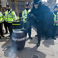 LONDON, ENGLAND - MAY 23: A 'Government of the Dead' campaigner holds a barrel of fake gunpowder aloft outside the Houses of parliament on May 23, 2009 in London, England. The group are calling for the sacking of MPs who's suspect expenses claims have recently been revealed by the media. Yesterday it was revealed that Ex-SAS officer John Wick leaked the data of all MPs' expenses to the Daily Telegraph after he had aquired them from an anonymous source...***Standard Licence  Fee's Apply To All Image Use***.Marco Secchi /Xianpix. tel +44 (0) 845 050 6211. e-mail ms@msecchi.com or sales@xianpix.com.www.marcosecchi.com