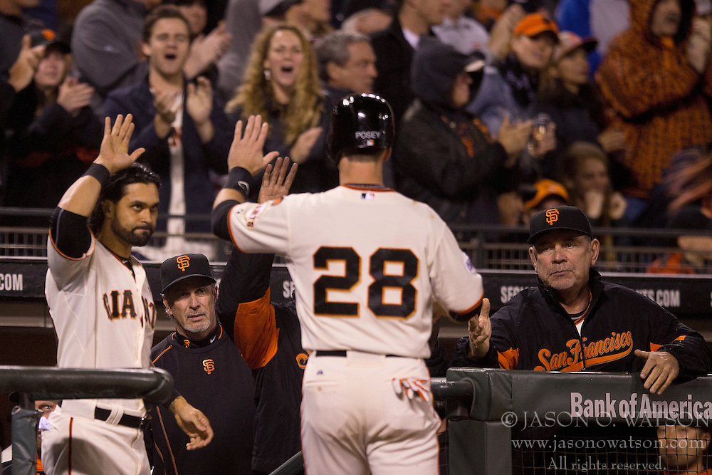 SAN FRANCISCO, CA - MAY 20:  Buster Posey #28 of the San Francisco Giants is congratulated by Angel Pagan #16 and manager Bruce Bochy #15 after scoring a run against the Los Angeles Dodgers during the sixth inning at AT&T Park on May 20, 2015 in San Francisco, California.  (Photo by Jason O. Watson/Getty Images) *** Local Caption *** Buster Posey; Angel Pagan; Bruce Bochy