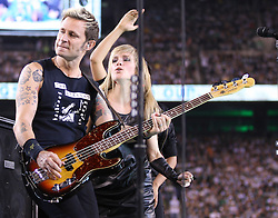 Sept 13, 2011; East Rutherford, NJ, USA; Green Day bassist Mike Dirnt performs during the half time show of the New York Jets-Baltimore Ravens game at the New Meadowlands Stadium.