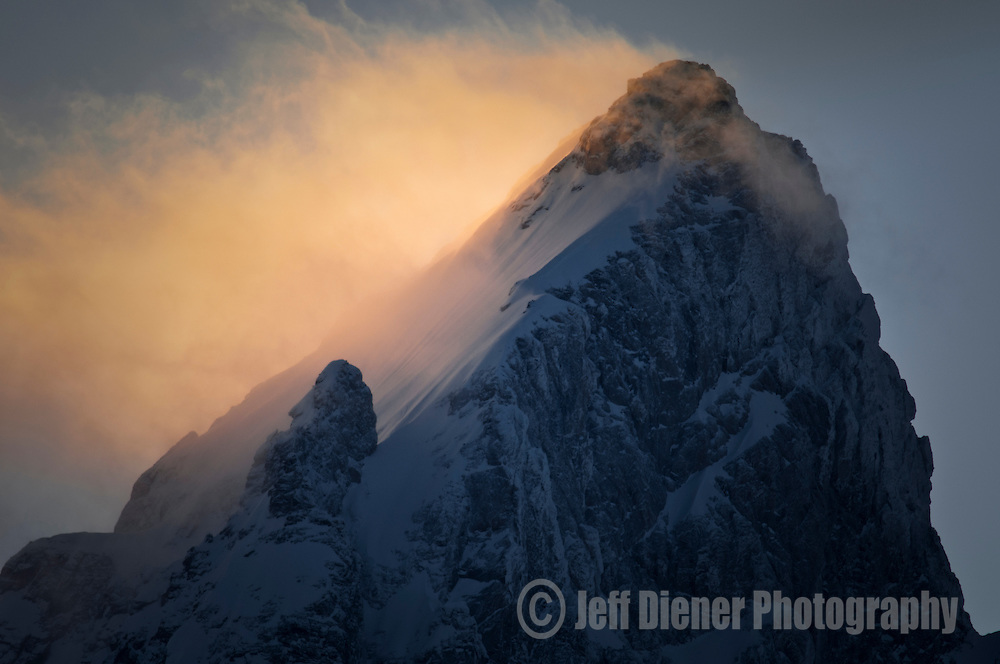 A banner cloud flags from the summit of the Grand Teton at sunset in Grand Teton National Park, Wyoming.