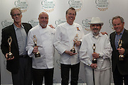 Holding their awards as Pioneers of American Cuisine, from left to right, Jasper White, Larry Forgione, Dean Fearing, Paul Prudhmme and Wolfgang Puck.