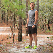 "Stephen Dees poses for a portrait at Carolina Beach State Park in Carolina Beach, N.C. where he trains for the upcoming Quintiles Wrightsville Beach Marathon. Dees, a competitive cross country runner in high school and college is running his first marathon. He took a break from competitive running after college saying he got ""burnt out."" Averaging 40-50 miles a week Dees says, ""this is the most training I've don't since college."" (Jason A. Frizzelle)"