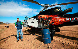 CANADA ALBERTA FORT MCMURRAY 10MAY07 - Refuelling the helicopter which uses one barrel of fuel per hour north of Fort McMurray, Alberta, Canada. The Alberta Tar Sands are the largest deposits of their kind in the world and their production is the single largest contributor to Canada's greenhouse gas emissions...Alberta's tar sands are currently estimated to contain a crude bitumen resource of 315 billion barrels, with remaining established reserves of almost 174 billion barrels, thus making Canada's oil resources ranked second largest in the world in terms of size...The industry has brought wealth and an economic boom to the region but also created an environmental disaster downstream from the Athabasca river, polluting the lakes where water and fish are contaminated. The native Indian tribes of the Mikisew, Cree, Dene and other smaller First Nations are seeing their natural habitat destroyed and are largely powerless to stop or slow down the rapid expansion of the oil sands development, Canada's number one economic driver...jre/Photo by Jiri Rezac / WWF-UK..© Jiri Rezac 2007..Contact: +44 (0) 7050 110 417.Mobile: +44 (0) 7801 337 683.Office: +44 (0) 20 8968 9635..Email: jiri@jirirezac.com.Web: www.jirirezac.com..© All images Jiri Rezac 2007 - All rights reserved.