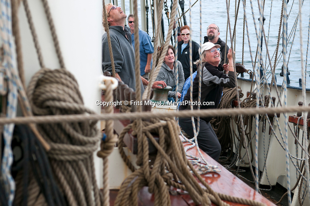 Ireland, July 2013. It is the first time that Tallship Thalassa, a barquentine sailing vessel with 3 masts, sails from Belfast to Galway along the Irish coastline. While a full-rigged ship is square-rigged on all three masts, and the barque is square-rigged on the foremast and main, the barquentine extends the principle by making only the foremast square-rigged. The advantages of a smaller crew, good performance before the wind and the ability to sail relatively close to the wind while carrying plenty of cargo made it a popular rig at the end of the 19th century. Photo by Frits Meyst/Adventure4ver.com