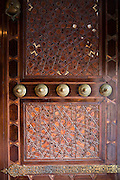 Ornate wooden carved entrance door at the Blue Mosque, Sultanahmet Camii or Sultan Ahmed Mosque, Istanbul, Turkey