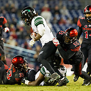 24 November 2018: San Diego State Aztecs defensive lineman Chibu Onyeukwu (55) brings down Hawaii Warriors running back Miles Reed (26) on a third down play late in the fourth quarter. Hawaii Warriors running back Miles Reed (26)The Aztecs closed out the season with a 31-30 overtime loss to Hawaii at SDCCU Stadium.