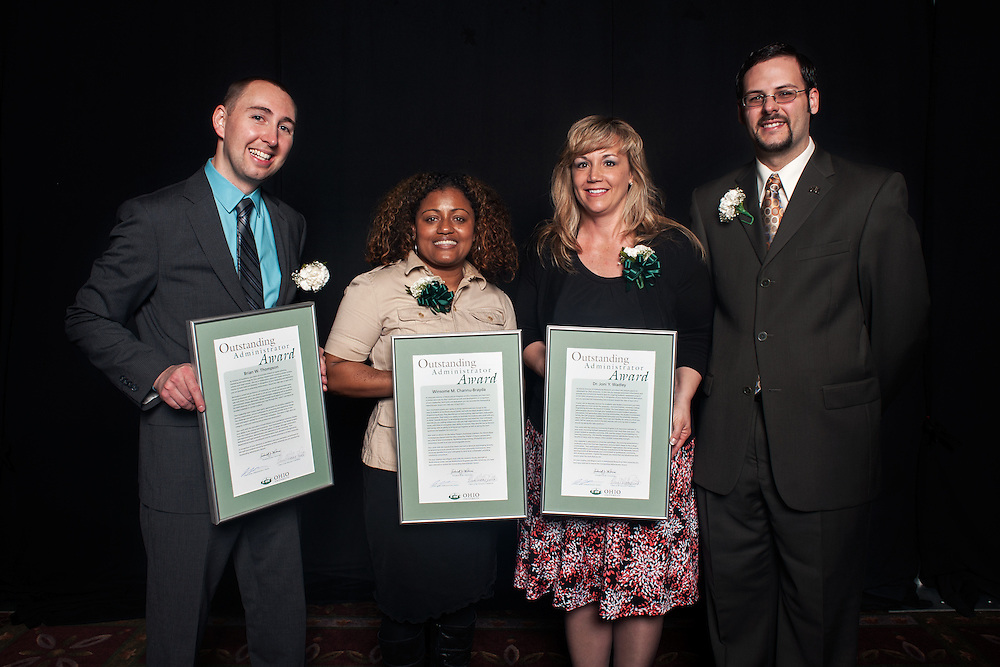 From left to right: Brian W. Thompson, Winsome Chunnu-Brayda and Joni Wadley pose with Administraitve Senate chair Joshua Bodnar after being given their outstanding administrator awards. Photo by: Ross Brinkerhoff.