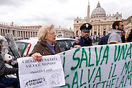 "Roma 27 Marzo 2015<br /> Flash mob degli  dell'Associazione Animalisti Italiani Onlus in Vaticano per  invitare i cattolici a non mangiare agnello per Pasqua. Rivolto un messaggio a Sua Santità Papa Francesco per  la campagna #SAVETHELAMB: ""Chi salva una vita salva il mondo"". per una Pasqua senza crudeltà. <br /> Rome March 27, 2015<br /> Flash mob of Italian Onlus Association Animalisti  in Vatican to invite Catholics not eat lamb for Easter. Sent a message to His Holiness Pope Francis for the campaign #SAVETHELAMB: ""Whoever saves one life saves the world."" for an Easter without cruelty."