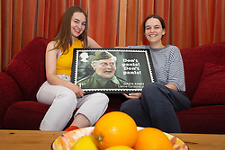 L-R Granddaughters Alice and Lydia admire a stamp design featuring Dad's Army's Clive Dunn. London, June 04 2018.