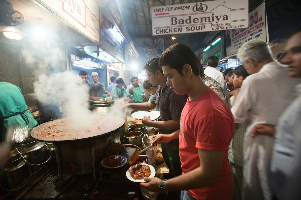Salman Sheikh grandson of the founder, serves customers at Bade Miyan Chicken Soup stall at the enterance of Minara masjid at Mohammed Ali road in Mumbai, Maharashtra, India, on Saturday September 6, 2009. Photographer: Prashanth Vishwanathan/The National