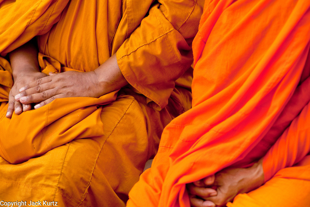 "10 MAY 2010 - BANGKOK, THAILAND: Buddhist monks rest their hands in their robes during a special memorial service for people killed in political street violence in Bangkok on April 10. The Red Shirts held a special memorial service at their main protest site in Ratchaprasong Intersection Monday with Buddhist monks leading chants to mark the one month anniversary of the street violence on April 10 that left 25 dead and more than 800 injured. Thai media is reporting that Prime Minister Abhisit Vejjajiva has given the Red Shirts has given the Red Shirts until the end of today to either accept his ""Road Map for Reconciliation"" and end the protest or face unspecified consequences widely thought to include a military crackdown.   Photo by Jack Kurtz / ZUMA Press"