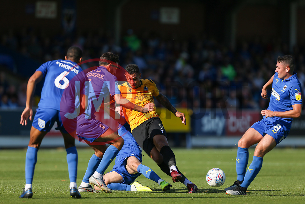 Callum Reilly of AFC Wimbledon tackles Jonson Clarke-Harris of Bristol Rovers - Mandatory by-line: Arron Gent/JMP - 21/09/2019 - FOOTBALL - Cherry Red Records Stadium - Kingston upon Thames, England - AFC Wimbledon v Bristol Rovers - Sky Bet League One