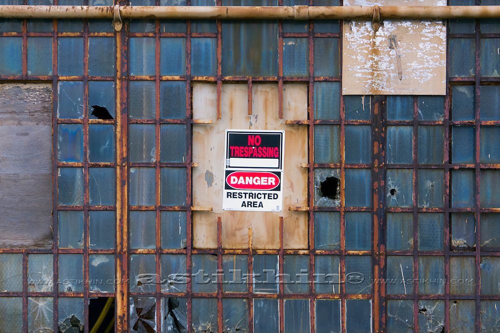 "Wall with ""No Trespassing"" sign."
