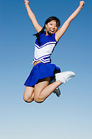 Cheerleader Performing Cheer in Mid-Air