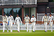 Middlesex team enter the field of play during the Specsavers County Champ Div 2 match between Middlesex County Cricket Club and Glamorgan County Cricket Club at Radlett Cricket Ground, Radlett, Hertfordshire, United Kingdom on 19 June 2019.