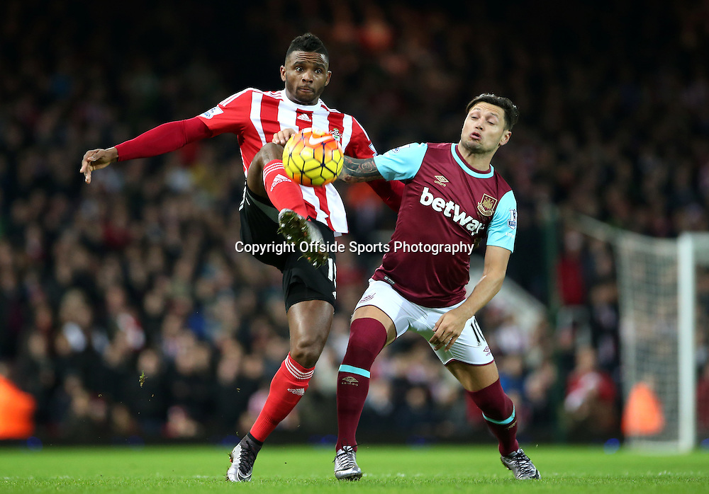 28 December 2015 - Premier League - West Ham United v Southampton<br /> Cuco Martina of Southampton keeps possession of the ball against Mauro Zarate of West Ham<br /> Photo: Charlotte Wilson / Offside
