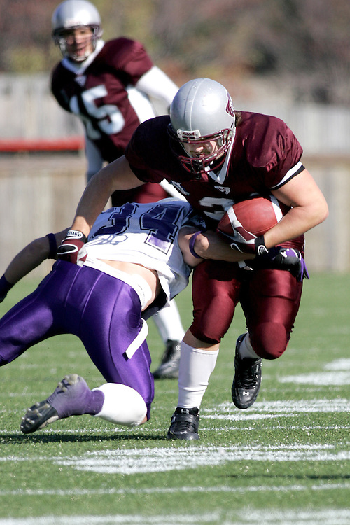 (3 November 2007 -- Ottawa) The University of Ottawa Gee Gees lost to the University of Western Ontario Mustangs 16-23 in OUA football semi-final action in Ottawa. The University of Ottawa Gee Gee player pictured in action is \mf
