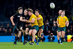 New Zealand Full Back Ben Smith is collected by Australia Flanker Michael Hooper after chipping up field to set up a try for New Zealand replacement Beauden Barrett (pictured L) - Mandatory byline: Rogan Thomson/JMP - 07966 386802 - 31/10/2015 - RUGBY UNION - Twickenham Stadium - London, England - New Zealand v Australia - Rugby World Cup 2015 FINAL.