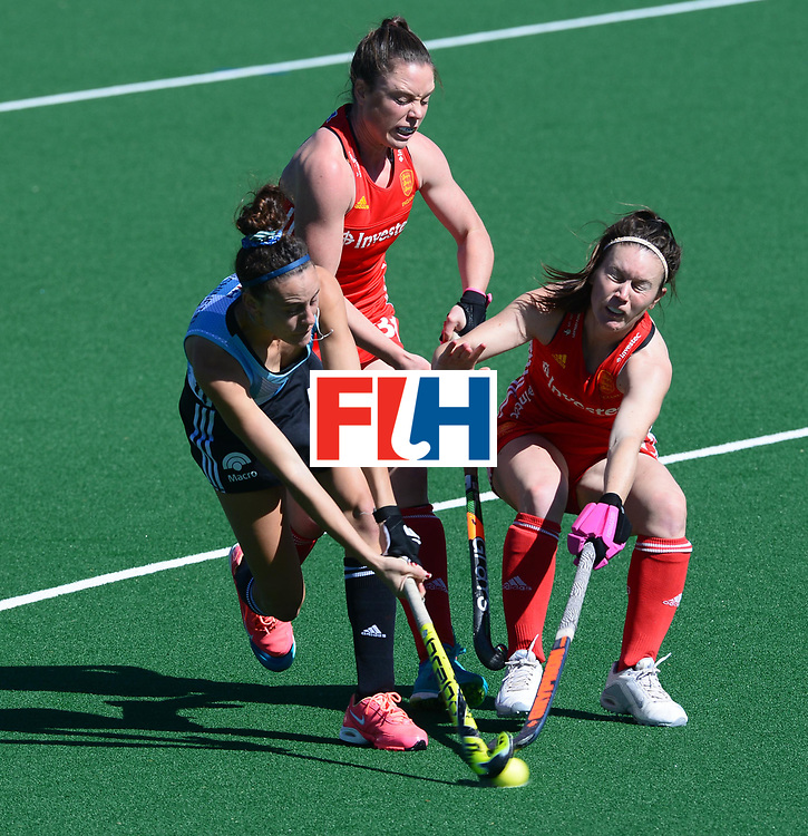 JOHANNESBURG, SOUTH AFRICA - JULY 23: Grace Balsdon and Laura Unsworth of England tackle Eugenia Trinchinetti of Argentina during day 9 of the FIH Hockey World League Women's Semi Finals 3rd-4th place match between England and Argentina at Wits University on July 23, 2017 in Johannesburg, South Africa. (Photo by Getty Images/Getty Images)