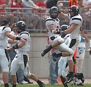 MORNING JOURNAL/DAVID RICHARD.Clyde High graduate Jared Martin, center, leaps in the air to celebrate after scoring Cincinnati's only touchdown on a 24-yard pass play from quarterback  Dustin Grutza, second from left, yesterday in the first quarter.