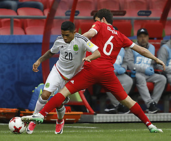 June 24, 2017 - Kazan, Russia - Georgy Dzhikya (R) of Russia national team and Javier Aquino of Mexico national team vie for the ball during the Group A - FIFA Confederations Cup Russia 2017 match between Russia and Mexico at Kazan Arena on June 24, 2017 in Kazan, Russia. (Credit Image: © Mike Kireev/NurPhoto via ZUMA Press)