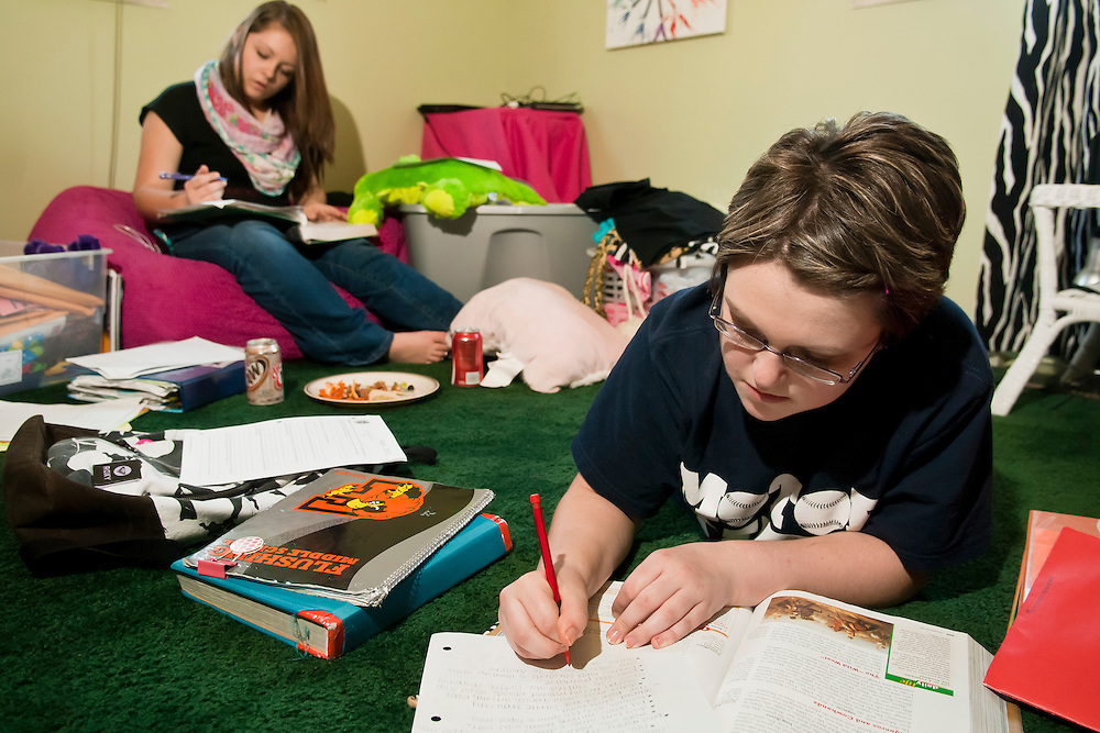 Lathan Goumas | MLive.com..Marrah Serban, 14, of Flushing Township does homework with her best friend Emily Murray, 13, of Flushing , on Wednesday May 23, 2012 at Marrah's home in Flushing Township, Mich.