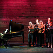 January 14, 2012 - Brooklyn, NY : ..From left, Marc Peloquin (piano), Paul Sperry (tenor), Mary Nessinger (mezzo-soprano), Deborah van Renterghem (soprano), Robert Osborne (bass-baritone), Emily Riggs (soprano), and Brandon Snook (tenor) perform the work of Charles Ives at the Galapagos Art Space in DUMBO, Brooklyn, on Saturday evening...CREDIT: Karsten Moran for The New York Times