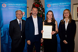 NEWPORT, WALES - Wednesday, December 12, 2018: Rebecca Crockett receives her certificate from Wales national team manager Ryan Giggs alongside Jean-Loup Chappelet, UEFA CFM Dean (L) and Valentina Mercolli, UEFA HatTrick Programme Manager (R) during the UEFA Certificate of Football Management Graduation Ceremony in the 2010 Clubhouse at the Celtic Manor Resort. (Pic by David Rawcliffe/Propaganda)