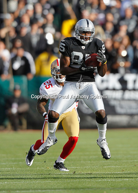 Oakland Raiders wide receiver Darrius Heyward-Bey (85) leaps to catch a pass good for a first down on the Raiders first drive during the NFL preseason week 3 football game against the San Francisco 49ers on Saturday, August 28, 2010 in Oakland, California. The 49ers won the game 28-24. (©Paul Anthony Spinelli)