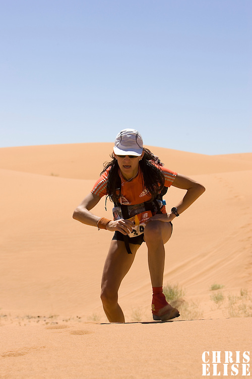 30 March 2007: #347 Laurence Fricotteaux of France climbs a dune in erg Znaigui en route to check point 3 during fifth stage of the 22nd Marathon des Sables between west of Kfiroun and erg Chebbi (26.22 miles). The Marathon des Sables is a 6 days and 151 miles endurance race with food self sufficiency across the Sahara Desert in Morocco. Each participant must carry his, or her, own backpack containing food, sleeping gear and other material.