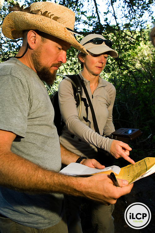 North American Cougar (Puma concolor couguar) biologists, Zachary Dautrich and Jen Joynt, checking camera traps, Tilden Regional Park, Berkeley, Bay Area, California