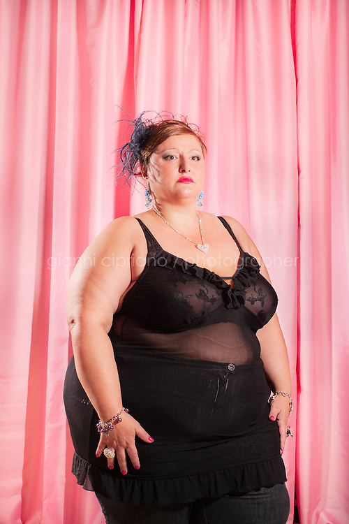 """FORCOLI, ITALY - 23 JULY, 2011: Susanna, 44, participates at Miss Cicciona (Miss Chubby), a pageant open only to women who weigh more than 220 pounds, in Forcoli, Italy. Miss Cicciona gives plus-size women, who could normally not eventer beauty pageants, an opportunity to take home a tiara. """"The competition aims to recognize and give light to the beauty and simple and true affection of women who usually ... are excluded from the spotlight,"""" wrote pageant founder Gianfranco Lazzereschi on the Miss Cicciona website."""