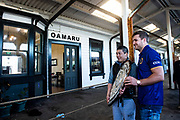 A fan gets a photos with Michael Collins of Otago with the Ranfurly Shield at Oamaru train station prior to the Ranfurly Shield match between Otago and North Otago, Oamaru, New Zealand, 26 July 2019. Credit: Joe Allison / www.Photosport.nz