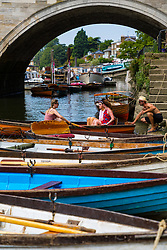 Friends set off on a row along the River Thames at Richmond in Surrey. London, July 25 2019.
