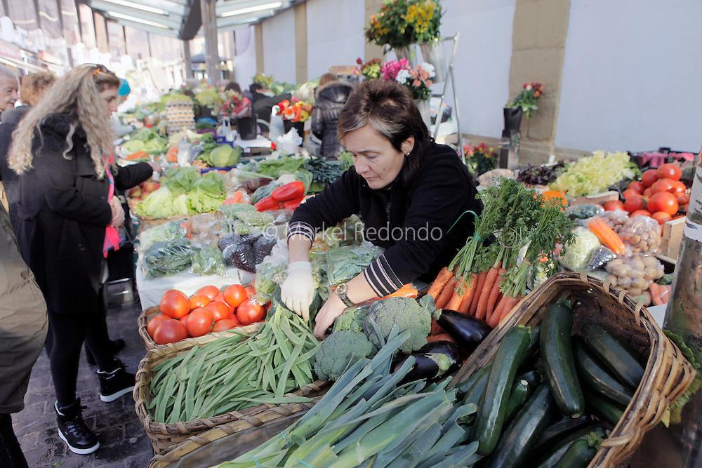 A group of tourist take a tour around a street food market in San Sebastian.