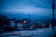 Evening light in the Roma part at the village of Rankovce in Slovakia. The foundation ETP Slovakia is working in Rankovce and setting up micro-loan funds for the local Roma community. Self-construction helps to demolish stereotyped views about people from socially excluded communities, whom the majority population regards as abusers of social benefits, socially dependent, incapable, passive and constantly reliant upon state assistance. The approach gives people the opportunity to take care of themselves.