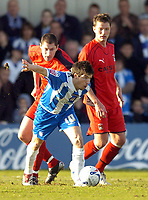 Photo: Olly Greenwood.<br />Colchester United v Coventry City. Coca Cola Championship. 10/03/2007. Colchester's Kem Izzet and Coventry's Colin Hawkins