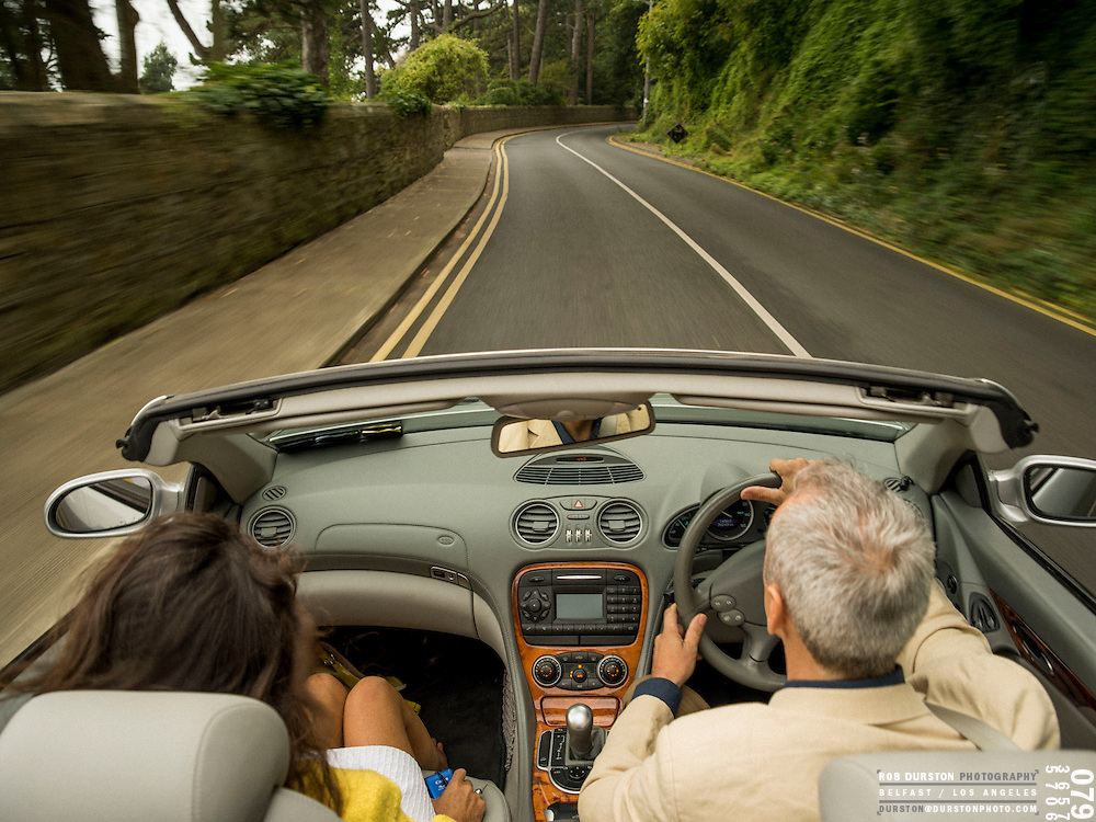 Couple driving in Vico Road along the coast of Killiney, Dublin