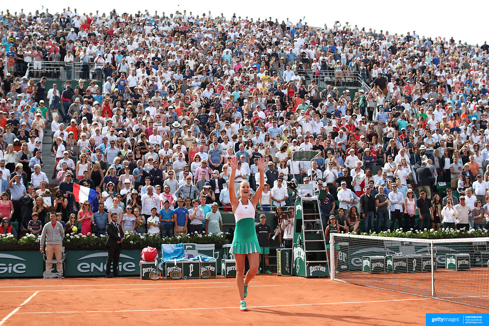 2017 French Open Tennis Tournament - Day Eight.  Kristina Mladenovic of France celebrate her win against Garbine Muguruza of Spain in the Women's Singles round four match in front of a full house on Suzanne-Lenglen Court at the 2017 French Open Tennis Tournament at Roland Garros on June 4th, 2017 in Paris, France.  (Photo by Tim Clayton/Corbis via Getty Images)