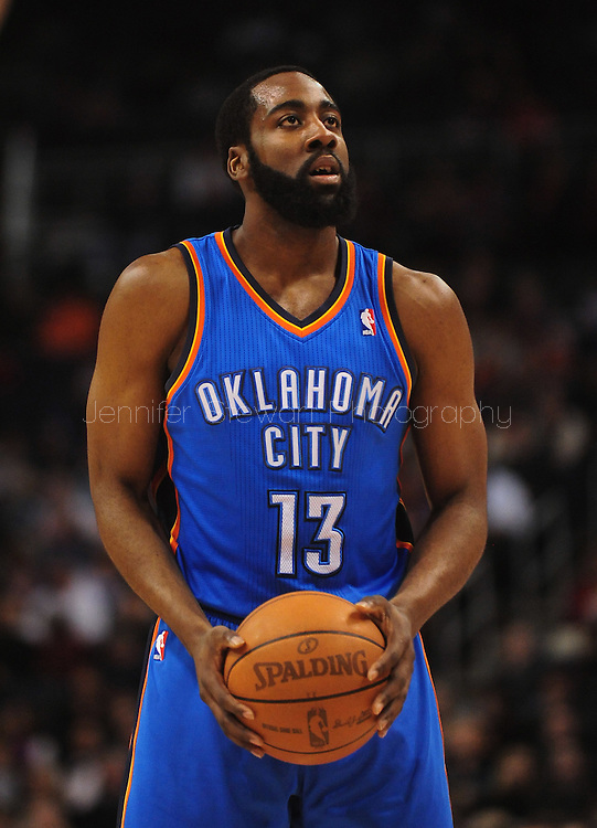 Feb. 4, 2011; Phoenix, AZ, USA; Oklahoma City Thunder guard James Harden (13) reacts on the court against the Phoenix Suns at the US Airways Center. The Thunder defeated the Suns 111-107. Mandatory Credit: Jennifer Stewart-US PRESSWIRE