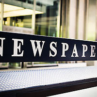 Picture of newspapers sign in downtown Chicago, Illinois, USA. Photo is high resolution and was taken in 2010.