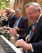 Photo by Phil Grout..Herb Sell, noted local jazzman, band and choral leader, knocks out another.lick on his keyboard as he and his musicians entertain the crowd at .Westminster's annual Flow and Jazz Festival.