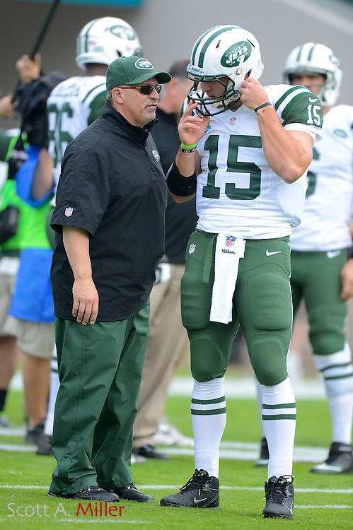 New York Jets quarterback Tim Tebow (15) with offensive coordinator Tony Sparano prior to an NFL game against the Jacksonville Jaguars at EverBank Field on Dec 9, 2012 in Jacksonville, Florida. ..©2012 Scott A. Miller..