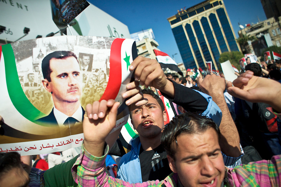 March 27, 2011 -- Syrian pro-government protesters demonstrate in the center of Aleppo, Sunday, March 28th, 2011. Dozens have died in recent days after anti-government protests in the southern city of Deraa and surrounding towns. Euronews reports sectarian reasons for the violence with Sunni majority pitted against supporters of the powerful Alawite minority.