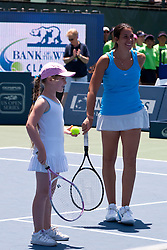 July 30, 2011; Stanford, CA, USA;  Marion Bartoli (FRA), right, plays an exhibition game with children after winning her match against Dominka Cibulkova (SVK), not pictured, during the semifinals of the Bank of the West Classic women's tennis tournament at the Taube Family Tennis Stadium. Cibulkova retired with an injury before the match began.
