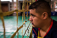 2016/06/02 &ndash; Bogotá, Colombia: Jonathan Fontes, 35, looks through a volleyball net during a training session at the High Performance Complex, Bogotá, 2nd June 2016. <br /> -<br /> Jonathan is a retired soldier of the Colombian army. In 2012, he stepped on an anti-personnel mine during a routine round in the Caqueta department, losing his right leg. At the beginning the process of recuperation was difficult, since he felt he was totally dependent on others. <br /> At first he started to focus on weightlifting sports, but found he was too tall. He was recommend to try seated volleyball, a sport that until then was unknown to him. Nowadays, he is the Captain of the Colombian team. The dream is to arrive to the Rio 2016 Paralympic games, but the national team only started to play the sport for the first time in 2011. <br /> The Colombian Volleyball net team finished 4th in the Pan-American Games of Toronto in 2015. Unfortunately they needed to have finished 2nd in order to qualify for a spot on this year Paralympics. Jonathan believes it still isn&rsquo;t the right time and that they have much more to learn. Instead they aim to work hard and be on the next Paralympics in Tokyo 2020. (Eduardo Leal)